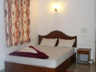 /cs-cz/drizzle-valley/hotel/munnar-in.html?asq=jGXBHFvRg5Z51Emf%2fbXG4w%3d%3d