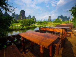 /ar-ae/yangshuo-hidden-dragon-villa-hotel/hotel/yangshuo-cn.html?asq=jGXBHFvRg5Z51Emf%2fbXG4w%3d%3d