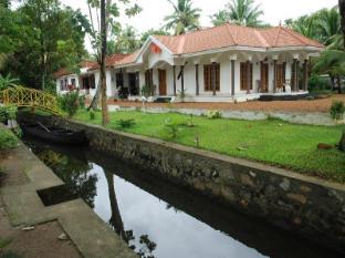 /da-dk/coconut-creek-kumarakom-homestay-hotel/hotel/kumarakom-in.html?asq=jGXBHFvRg5Z51Emf%2fbXG4w%3d%3d