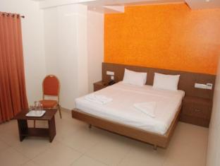 /da-dk/pl-a-amrith-inn/hotel/karur-in.html?asq=jGXBHFvRg5Z51Emf%2fbXG4w%3d%3d